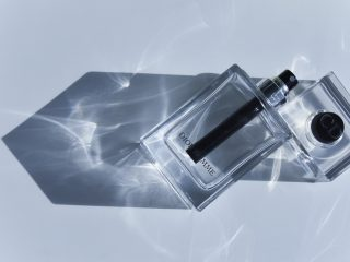 the bottle of Christian Dior Homme perfume with the sunlight goi