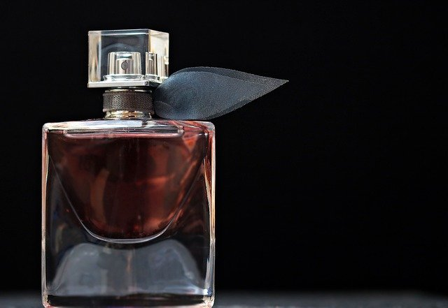 bottle-of-perfume-with-black-background-resembling-mercedez-benz